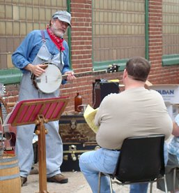 Matt Dodd entertains visitors with songs and tales of the rails.  Andrew Dietz photo.
