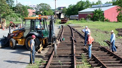 RCT&HS volunteers work on laying a third display track at the Reading Railroad Heritage Museum.  Jeff Smith photo.